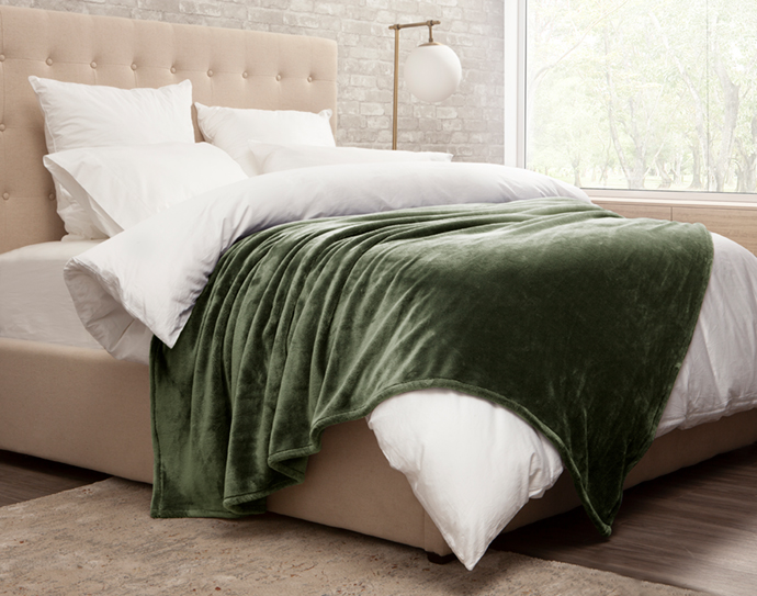 Cashmere Touch Blanket in Green on Bed